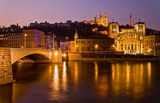 Napoleon Bridge, Saone River and Fourviere Hill at night. Lyon, France